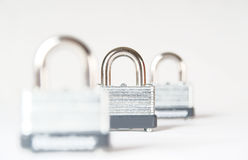 Three locked padlocks isolated Royalty Free Stock Photo