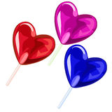 Three lollipops in the shape of heart. Vector Stock Photos