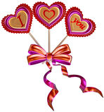 Three lollipops tied with a bow with long ribbons Stock Photos