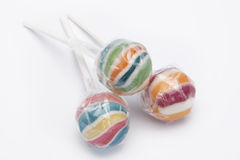 Three lolly pops. With pastic Royalty Free Stock Photos