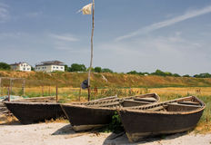 Three lone fishing boats on a sandy shoreline scenery Stock Photography