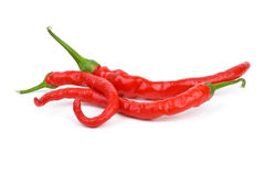 Three long curved red hot chili peppers Stock Photography