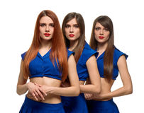 Three long-haired women portrait. triplets sisters Royalty Free Stock Image
