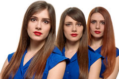 Three long-haired women. triplets sisters Royalty Free Stock Images