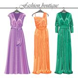 Three long silk party dresses on a hanger.Fashion  Stock Image