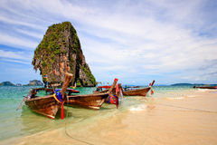 Three Longtail Boat on Beach Royalty Free Stock Photography