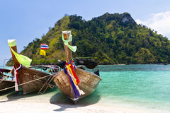 Three longtail boats on beach Royalty Free Stock Photos