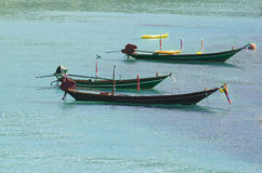 Three longtail boats on the water - traditional Thailand. Background Stock Images