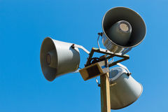 Three loudspeakers on a column Stock Photos