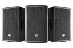 Three loudspeakers on a white background. Three black loudspeakers on a white background Royalty Free Stock Images