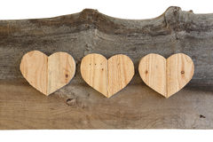 Three Love Valentines wooden hearts on old Elm background Royalty Free Stock Image
