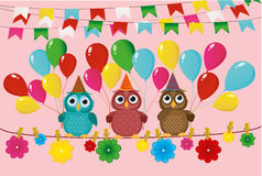 Three lovely owls sit on a rope and hold balloons. Flags Royalty Free Stock Image