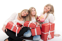 Three lovely sisters with presents Stock Photo