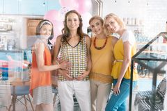 Three loving friends surrounding their pregnant lady stock photography