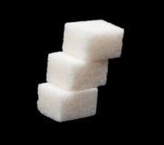 Three lumps of sugar Stock Photo
