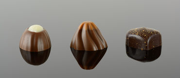 Three luxury chocolates Royalty Free Stock Photography