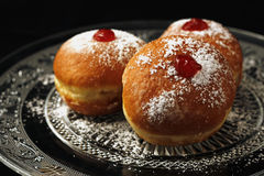 Three luxury sufganiyot for Chanukkah Stock Photos