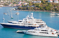 Three Luxury Yachts in Blue Bay Royalty Free Stock Photo