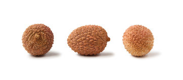 Three lychee fruits  on a white background Royalty Free Stock Photo