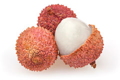 Three lychees  on white Royalty Free Stock Image