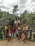 Three Maasai with his face painted Royalty Free Stock Image