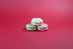 Three Macarons. Stack of Three Macarons On Red Background royalty free stock photo