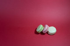 Three Macarons. Stack of Three Macarons On Red Background stock photography