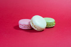 Three Macarons. Stack on a red background stock photography