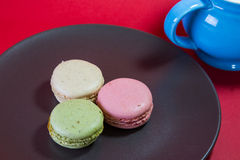 Three Macarons. Stack on a red background Royalty Free Stock Photo