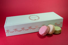 Three Macarons. Stack on a red background royalty free stock image