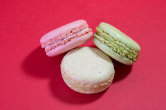 Three Macarons. Stack on a red background stock image