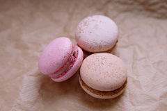 Three macaroons on craft paper Royalty Free Stock Photography