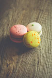 Three macaroons on craft paper Royalty Free Stock Images