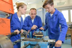 Three machinist at work royalty free stock photos