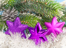 Three magenta snowflakes on al background of New Year's branches.Christmas still life Stock Photography