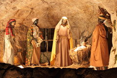 Three Magi and Jesus Christ scene Stock Images