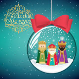 Three magic kings in Christmas decoration ball. The three magic kings in Christmas decoration ball. Happy Epiphany written in Spanish Royalty Free Stock Photography