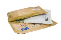 Three mail package. Isolated on the white background with clipping path. Shallow depth of field Stock Images