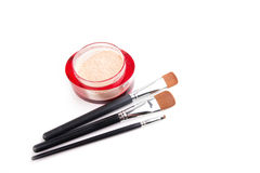Three make-up brushes and powder isolated on white Stock Images