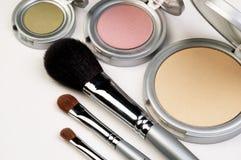 Three Makeup Brushes and Blush. Closeup of three makeup brushes and three colors of blush Stock Photos