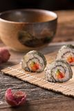 Three delicious vegan sushi rolls, vertical close-up royalty free stock photo