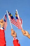 Three malaysia flag. On blue sky background Royalty Free Stock Image