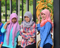 Three Malaysian girls wearing headscarves - Stock Image. The photo was shoot on October 5, 2014 in front of the National Palace of Malaysia , The three girls are stock images