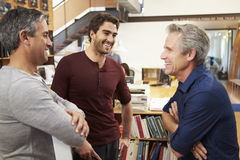 Three Male Architects Chatting In Modern Office Together. Three Happy Male Architects Chatting In Modern Office Together Looking At Each Other royalty free stock image