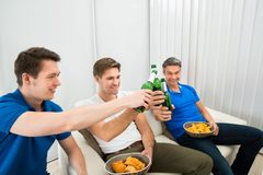 Three male friends having party stock photos
