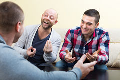 Three male friends talking at home Stock Photography