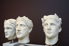 Three male heads sculptures in Classical Greek style Royalty Free Stock Image