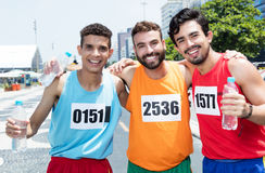 Three male runners after a marathon race in city Royalty Free Stock Image
