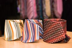 Three man ties collection. Three colorful man's ties lying on a table Royalty Free Stock Image