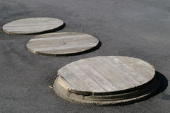 Three Manhole Covers Stock Images